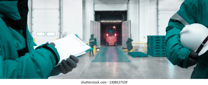 Staff worker with clipboard checking goods and Safety Officer for dangerous in Cold room storage and freezing warehouse. Teamwork concept. Banners with copy space.