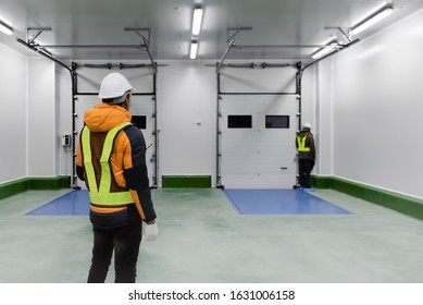 Staff worker standing control inside loading room for goods in Cold Warehouse storage, Loading for delivery in freezer. Engineering service, Technician service.