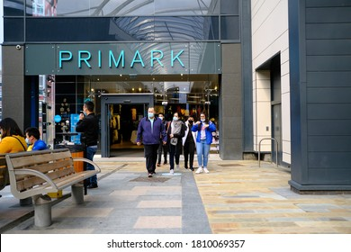 Stafford / UK - September 5 2020: Primark shop front and family in viral masks walking out of it.