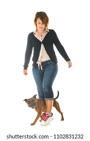 staffordshire bull terrier and woman in front of white background