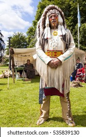 Staffordshire, England. - June 21st 2014 : Man dressed in the traditional costume of a Native American Indian Chief Warrior at Leek's Country and Western weekend. Leek, Staffordshire, England.