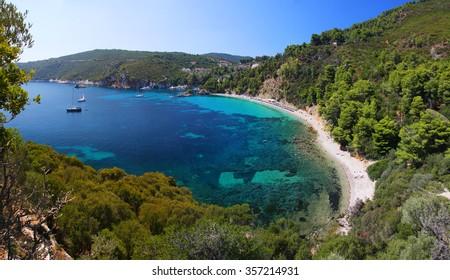 Stafilos bay sand beach with turquoise water, Skopelos island, Greece