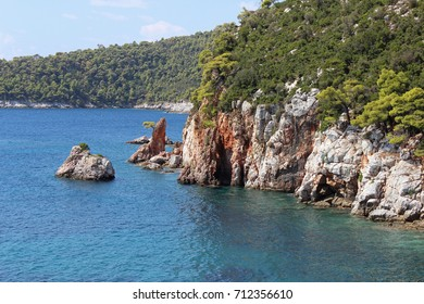 Stafylos skopelos greece aegean europe mediterranean bay seascape landscape blue turquoise postcard clear clean calm composition coast line rock cave