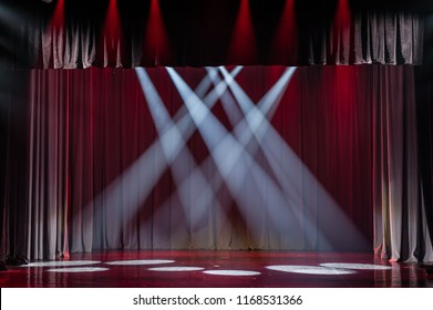 Stage background with lights. Soft focus. lluminated scene. Red and white spotlights. Light effect. Nobody.