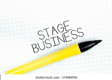 STAGE BUSINESS concept write text on notebook
