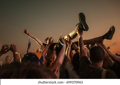 Stage diving. Crowd surfing during a musical performance
