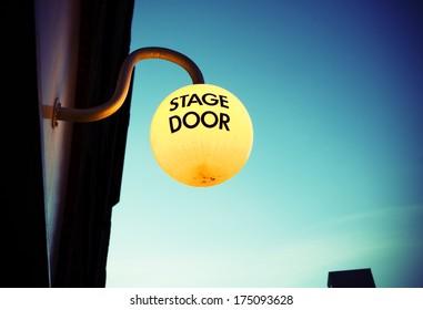 Stage door light at dusk