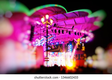 Stage illuminated in neon lights in green and purple. Great for background.