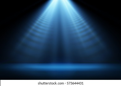 Stage light and blue glitter lights on floor. Abstract background for display your product. Spotlight realistic ray