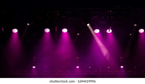stage light with colored spotlights and smoke, concert scene