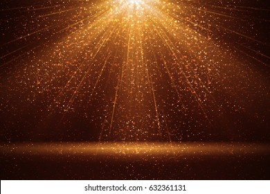 Stage light and golden glitter lights on floor. Abstract gold background for display your product. Spotlight realistic ray.