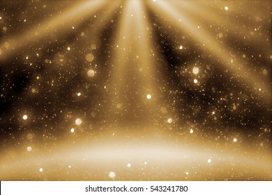 Stage light and goldenr glitter lights on floor. Abstract Christmas golden  festive background for display your product. Spotlight realistic ray