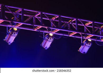 stage light on the metal frame in the dark