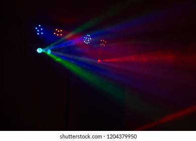 Stage lights in action at the concert. Lights show. Lazer show. Night club dj party people enjoy of music dancing sound with colorful light. club night light dj party club. Smoke Machine and lights