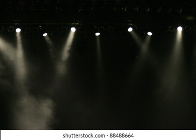 stage lights against dark background