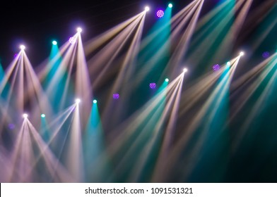 Stage lights on concert. Lighting equipment with multicolored beams