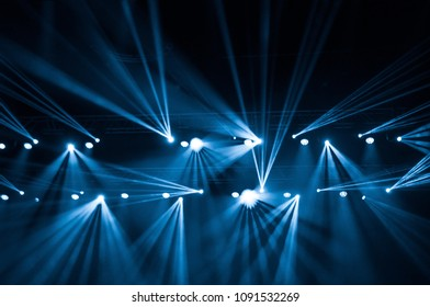 Stage lights on concert. Lighting equipment with beams