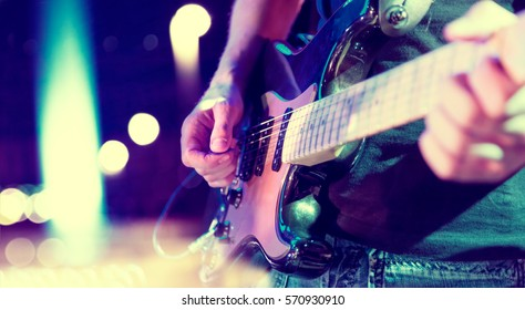 Stage lights.Abstract musical background.Playing guitar and concert concept.Live music background.Music festival.Instrument on stage and band - Shutterstock ID 570930910