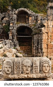 Stage masks in front of ruins at Myra Turkey