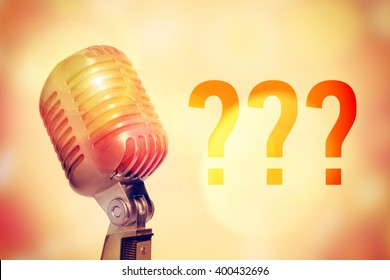 Stage microphone on a glowing abstract background with an inscription Question mark. Toned