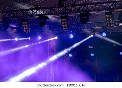 stage rig with lightning equipment. blue stage lights during the performance