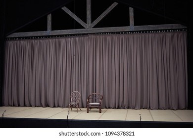 Stage in theatre with curtain. chair, armchair, microphones.