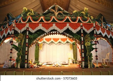 A stage traditional decorated for a hindu wedding.