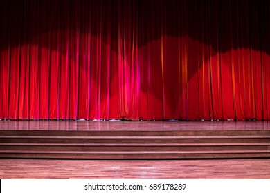 Stage wood with ladder and red curtains in a theater.