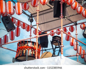 The stage of the Yaguro. Paper red-white lanterns Chochin Scenery for the holiday Obon when people dance of Bon Odori