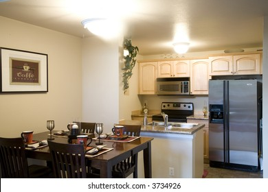 Staged dining room and kitchen