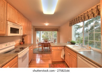 Staged kitchen with dining room in townhouse