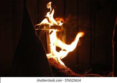 Staged meeting of the KKK, looking at a burning cross.  Photojournalism look and feel. - Shutterstock ID 376523614
