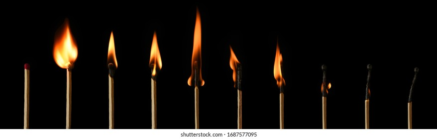 The stages of match burning on a black background. Safe match with red head. Different stages of matchstick burning. From Ignition to decay. Copy space, banner.