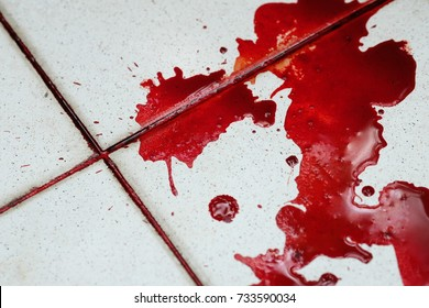 Stain of blood on the floor in a murder scene