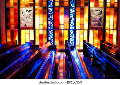 stain glass reflections reflected off of church pews
