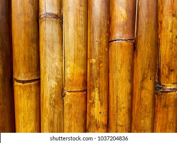 A stained bamboo fence