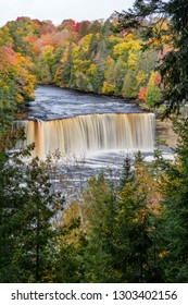 Stained by tannins in the water, Upper Tahquamenon Falls plunges in the midst of changing autumn leaves.