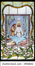 stained glass baptism of jesus on black background
