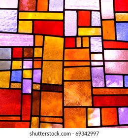 Stained glass church window in a reddish tone, square orientation