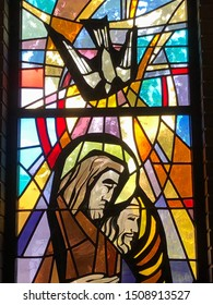 Stained Glass image of the Holy Trinity. Taken at St. Clement of Rome, Metairie, La on September 9, 2019.