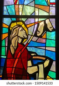 Stained Glass image of Jesus washing Apostles' feet.  Taken at St. Clement of Rome Church in Metairie, LA on September 9, 2019.