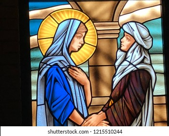 Stained Glass image of Mary visiting Elizabeth taken at St Elizabeth Seton Catholic Church in Ocean Springs, MS on Oct 27, 2018