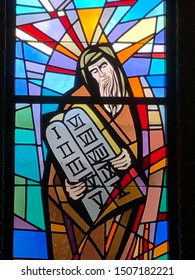 Stained Glass image of Moses and the Ten Commandments. Taken at St. Clement of Rome Church in Metairie, LA. On September 9, 2019.