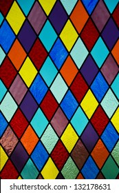 Stained glass with multi-colored diamond pattern