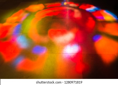 Stained Glass Reflection - stained glass window - a reflection of light on the stone floor