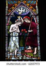 Stained glass showing baptism of Jesus