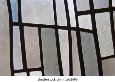 Stained glass in subtle pastel shades. Interesting design background.