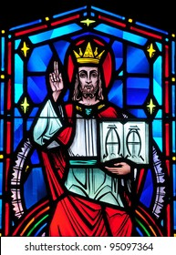 Stained glass window of Christ the King, Alpha and Omega