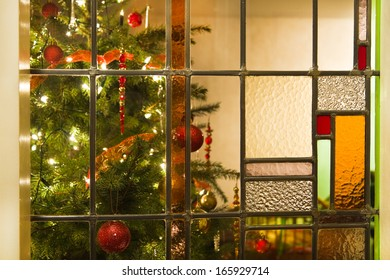 Stained glass window and decorated christmas tree - horizontal