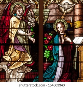 Stained glass window depicting Bible story of the Annunciation of Angel Gabriel to the Blessed Virgin Mary